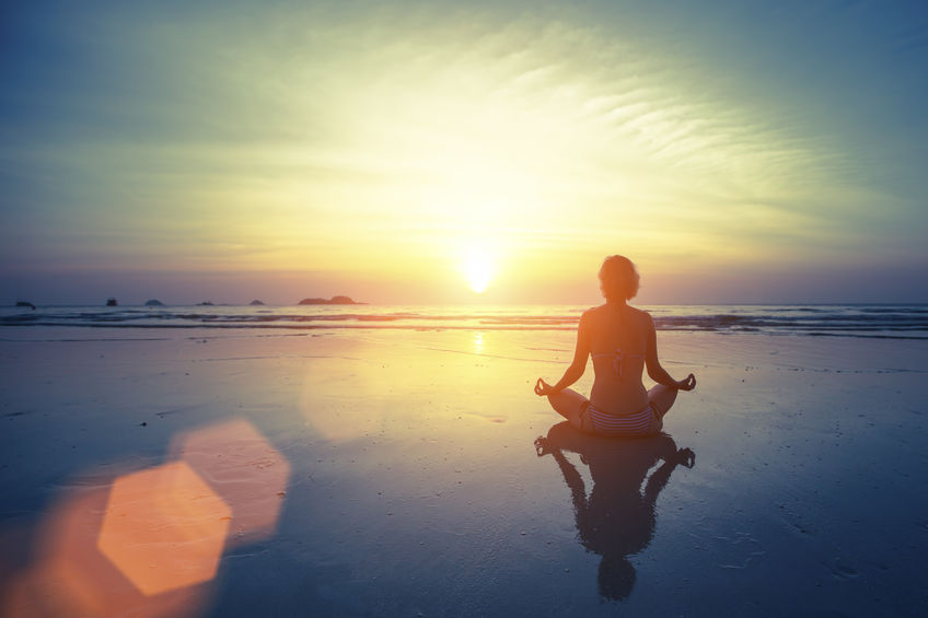 48954944 - silhouette meditation yoga woman on the background of the sea and amazing sunset. healthy lifestyle.