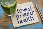 55759391 - invest in your health advice or reminder - handwriting on a napkin with a glass of fresh, green, vegetable juice